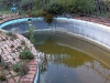 Old and dirty fibreglass pool